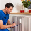 Technician reading the heat meter — Stockfoto