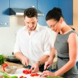 Young couple cooking - man — ストック写真