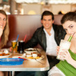 Three friends in a restaurant or — Stock Photo