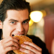 Stock Photo: Man in a restaurant or diner