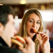 Couple in a restaurant or diner - Stock Photo