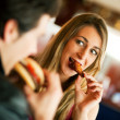 Couple in a restaurant or diner — Stock Photo