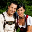 Couple in traditional Bavarian - Stock Photo
