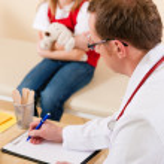 Pediatrician is examining his — Stock Photo