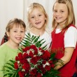 Stock Photo: Girl child giving flowers to her