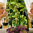 Mature couple eating romantic - Stockfoto