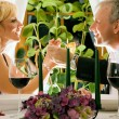 Mature couple eating romantic — Stock Photo