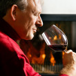 Mature man enjoying a glass of  — Stock Photo