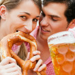 Couple in traditional German - Stock Photo
