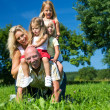 Very happy family with three — Stock Photo #5024133