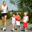 A young mother jogging with — Stock Photo #5024139