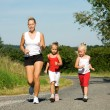 A young mother jogging with — Stock Photo