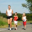 A young mother jogging with — Stock Photo #5024140