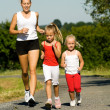 A young mother jogging with — Stock Photo #5024141