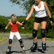 A young mother roller skating  — Stockfoto