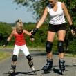 A young mother roller skating — Stock Photo