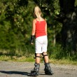 Young girl on rollerblades, - Photo