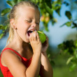 Little girl nibbling — Stock Photo