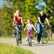 Family with one child riding — Stock Photo