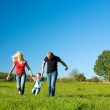 Active family running down a — Stock Photo #5024186