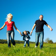 Active family running down a — Stockfoto