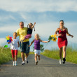 Family with three kids running - Stock Photo