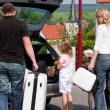 Stok fotoğraf: Family travelling by car to their vacation