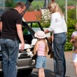 Family travelling by car to their vacation — Stockfoto
