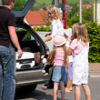 Family travelling by car to their vacation - Lizenzfreies Foto