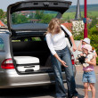 Family travelling by car returning from vacation — Stock Photo