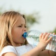 Kid drinking water from a bottle — Stock Photo