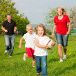 Foto Stock: Happy family playing football