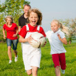 Happy family playing football — Stock Photo