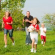 Happy family playing football — Foto de stock #5024349