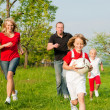 Happy family playing football — Stockfoto #5024350