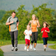 Family jogging outdoors with — Stock Photo #5024352