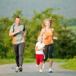 Family jogging outdoors with — Stock Photo