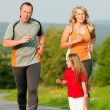 Family jogging outdoors with — Stock Photo #5024356
