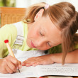 Girl preparing her homework — Stock Photo