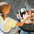 Little girl preparing meat and — Foto de Stock