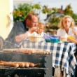 Stock Photo: Family having a barbecue in the