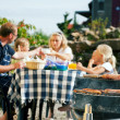 Stock Photo: Family having barbecue in the