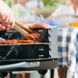 Family having a barbecue in the — Stock Photo #5024415