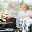 Family having a barbecue in the — Stock Photo #5024416