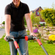 Man mowing lawn in his garden — Stock Photo #5024417
