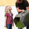 Father and Child mowing the - Stock Photo