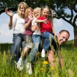 Very happy family with three — Stock Photo