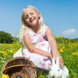Child petting the Easter bunny — Stock Photo