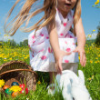 Child petting the Easter bunny — Stock Photo #5024480