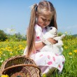 Child petting the Easter bunny — Stock Photo #5024481